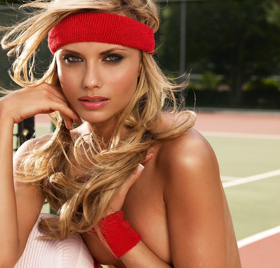 A beautiful blonde at the net on a tennis court : Free Stock Photo