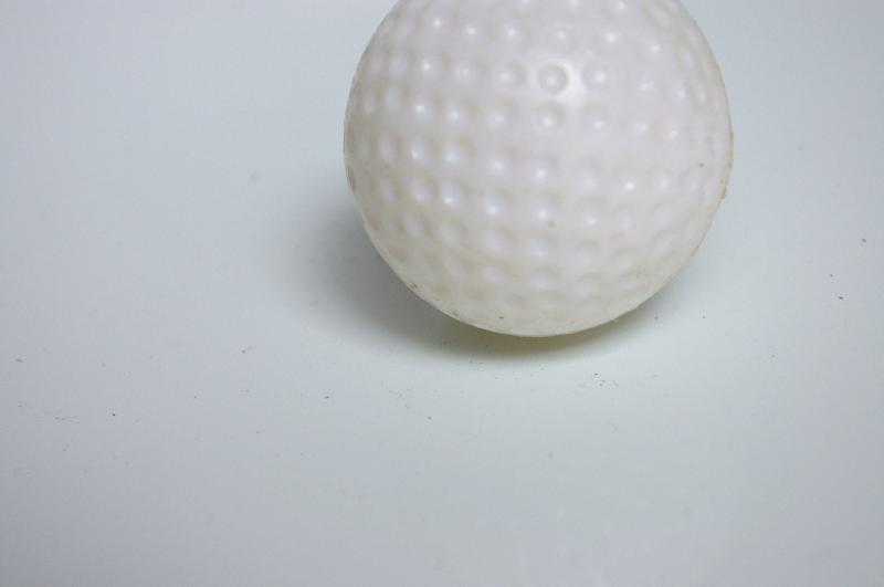 A plastic golf ball isolated on a white background : Free Stock Photo