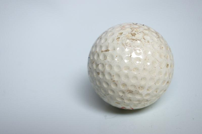 A golf ball isolated on a white background : Free Stock Photo