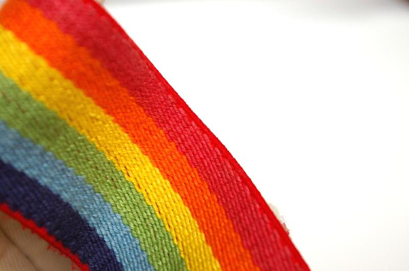 A rainbow colored band isolated on a white background : Free Stock Photo