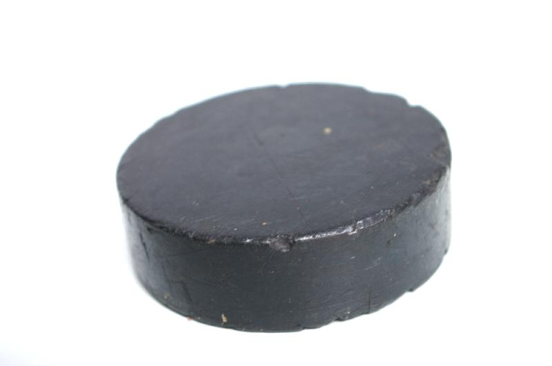 A black hockey puck isolated on a white background : Free Stock Photo
