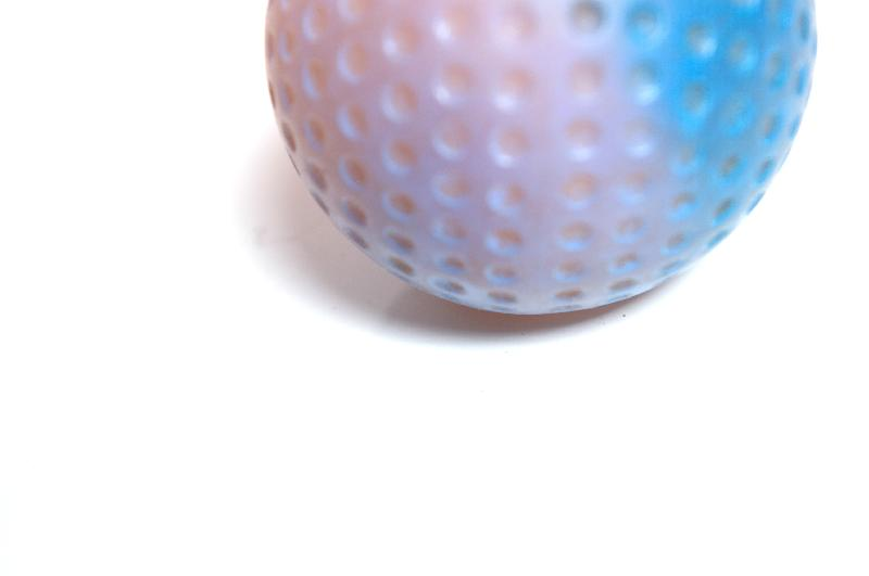 A blue golf ball isolated on a white background : Free Stock Photo