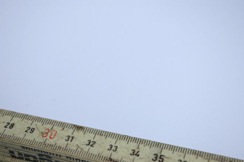 A fold up ruler isolated on a white background : Free Stock Photo