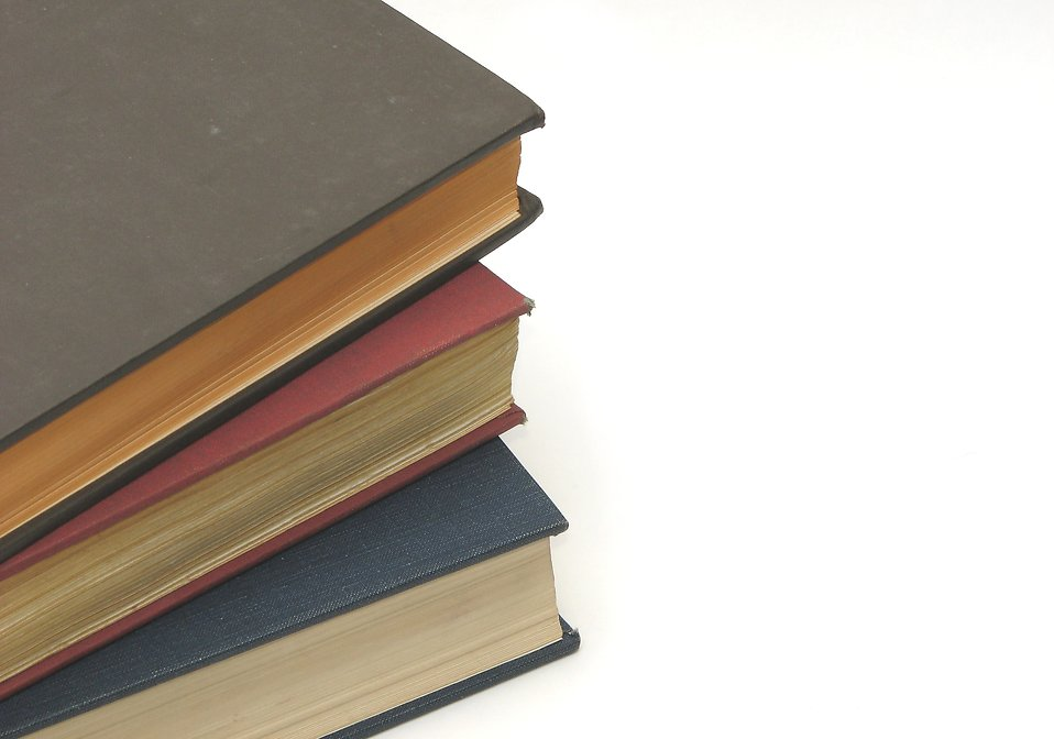 A stack of books isolated on a white background : Free Stock Photo