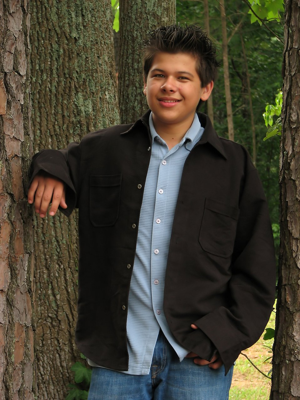 A young latino teen boy posing outdoors by a tree : Free Stock Photo