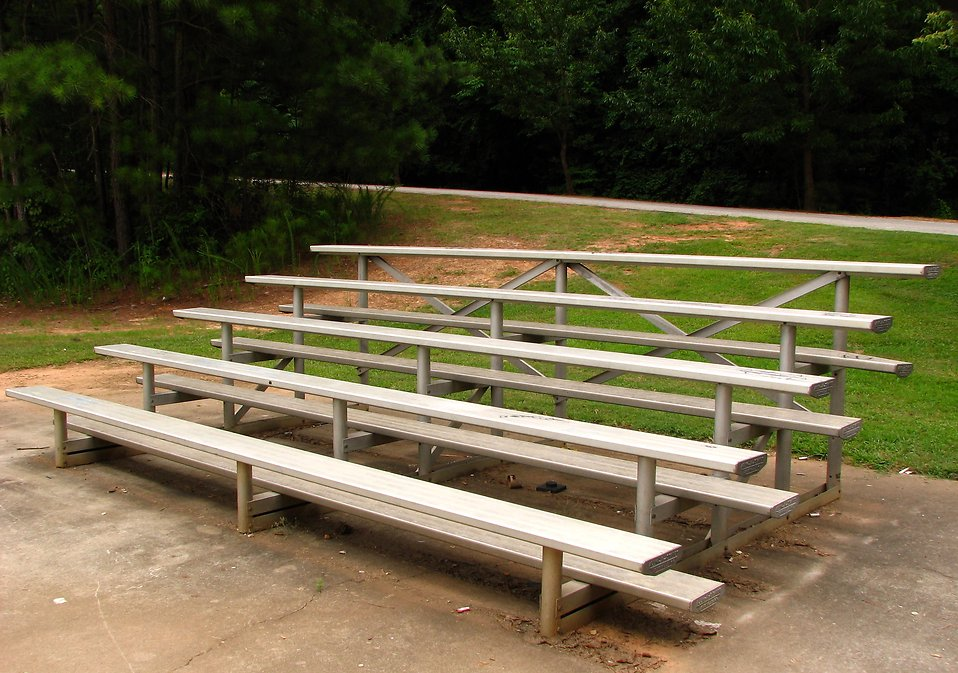 A small set of bleachers in a park : Free Stock Photo