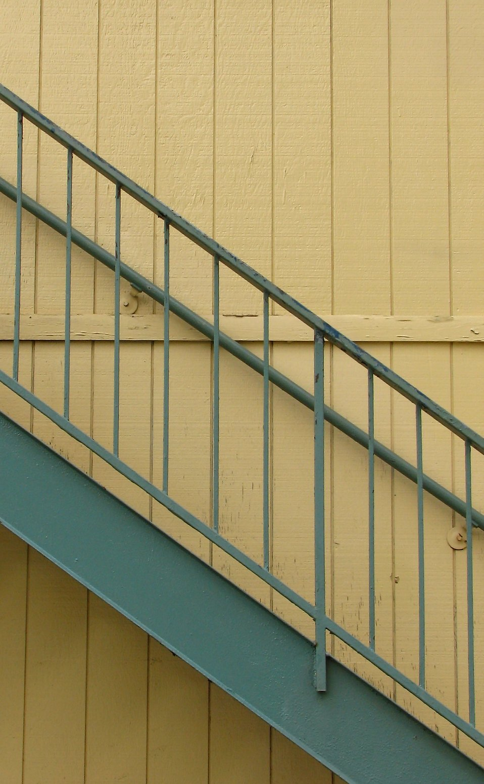 Steps on the side of a yellow building : Free Stock Photo