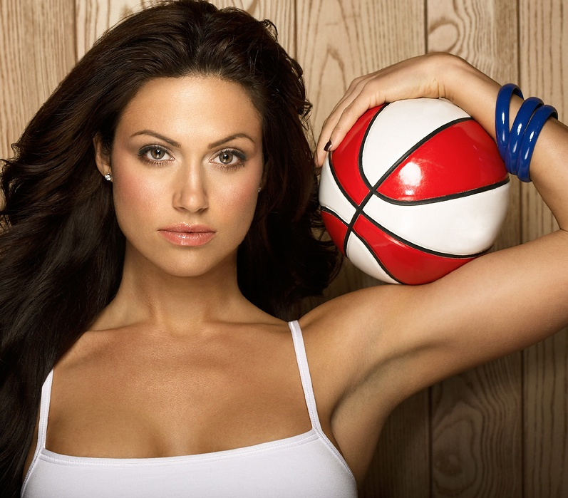 A beautiful woman posing with a basketball : Free Stock Photo