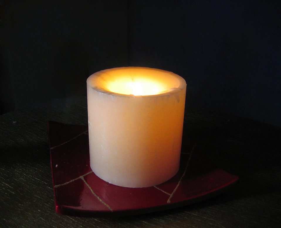 A white candle burning : Free Stock Photo