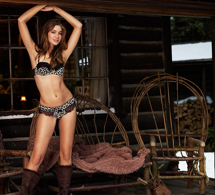 A beautiful woman posing in lingerie outside of a log cabin : Free Stock Photo