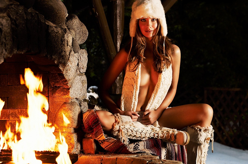 A beautiful woman in lingerie posing by a fire : Free Stock Photo