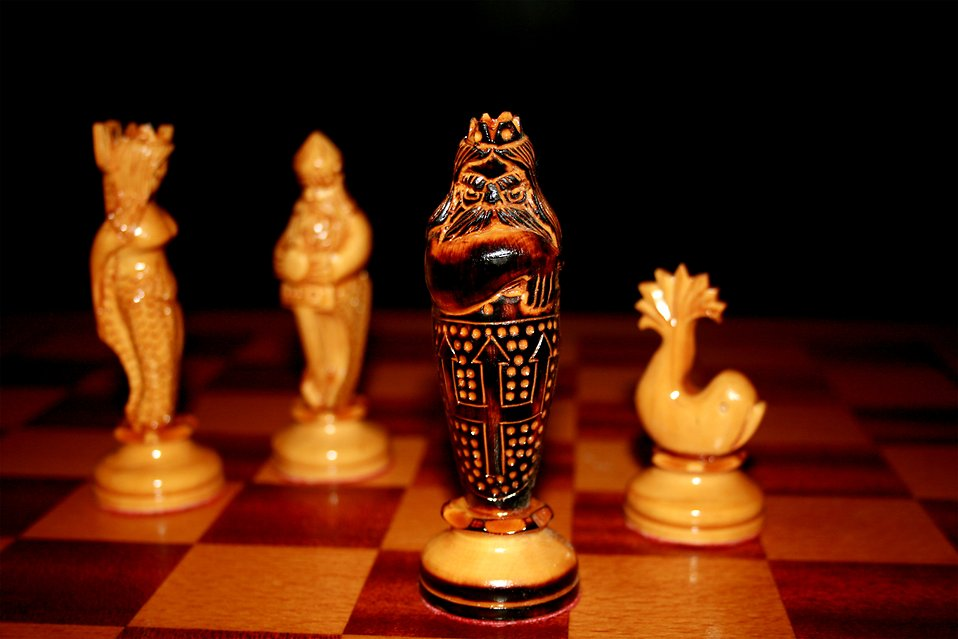 Ornate chess pieces in checkmate : Free Stock Photo