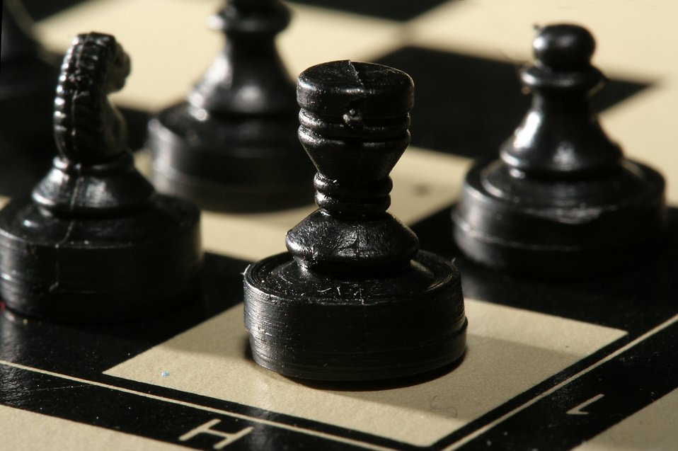 Close-up of a miniature black chess rook piece : Free Stock Photo