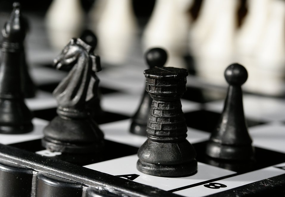 Close-up of a black chess rook piece : Free Stock Photo