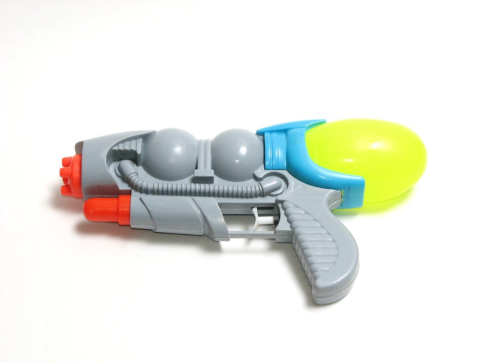 A futuristic squirt gun isolated on a white background : Free Stock Photo