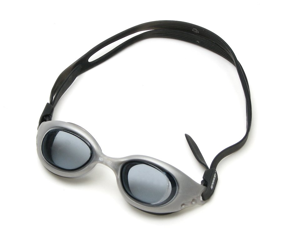 A pair of swimming goggles isolated on a white background.