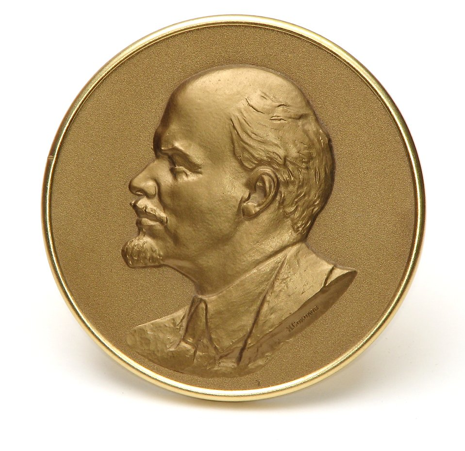 A gold coin with a Lenin portrait isolated on a white background : Free Stock Photo
