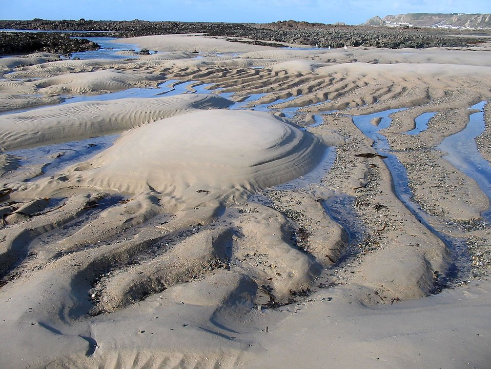 Sand with puddles of water : Free Stock Photo