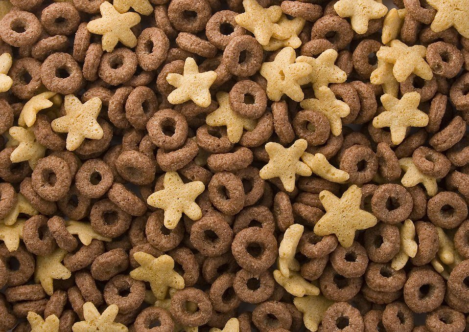 Close-up of round and star shaped breakfast cereal : Free Stock Photo