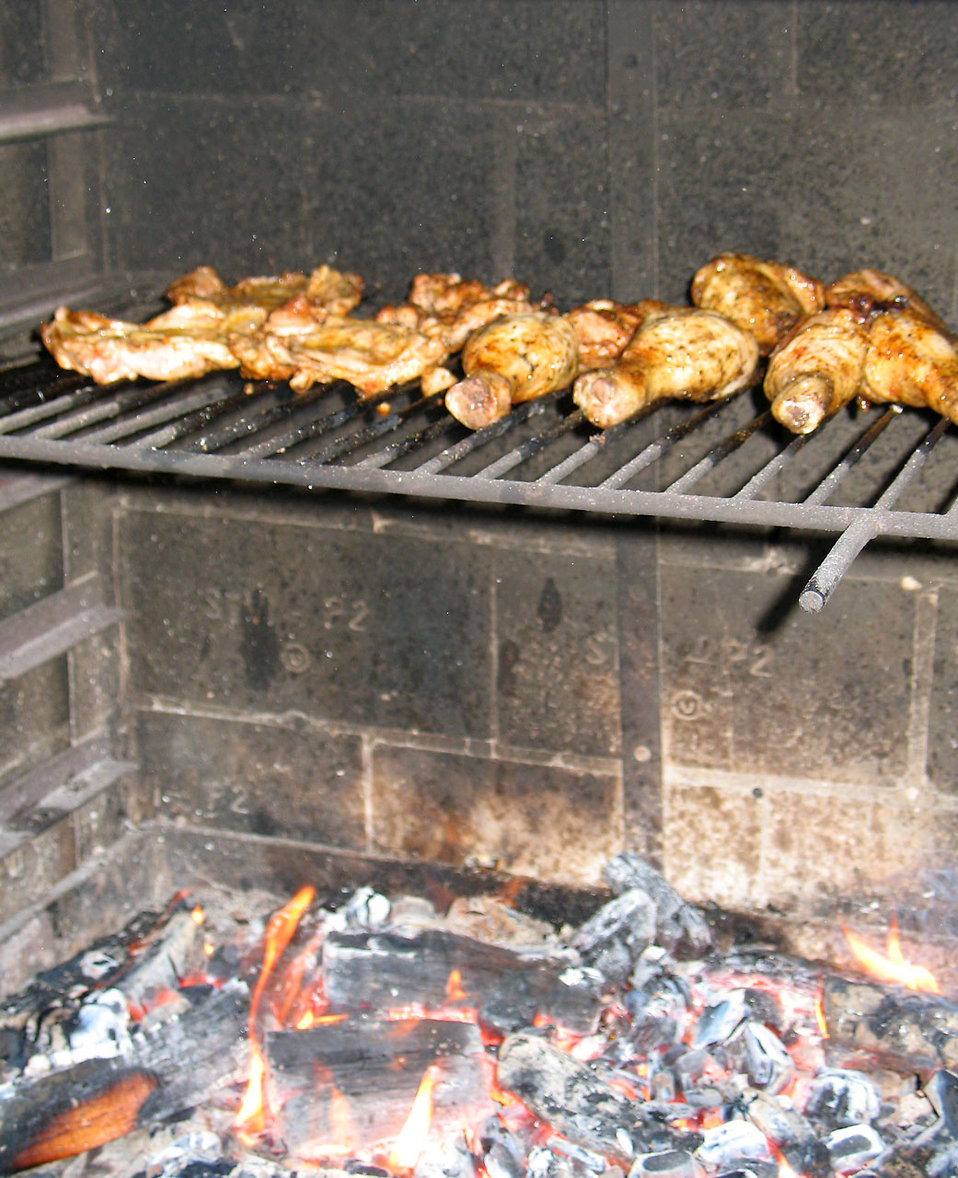 Chicken roasting over a fire : Free Stock Photo