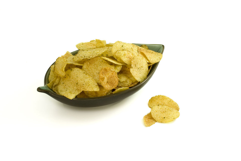 Potato chips in a bowl isolated on a white background : Free Stock Photo