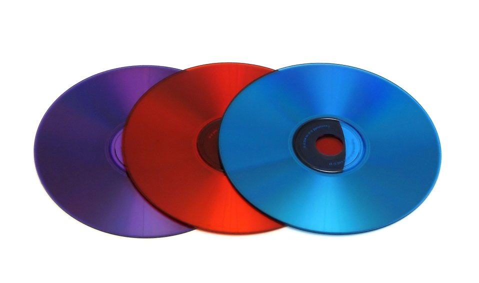 Colored cds isolated on a white background. : Free Stock Photo