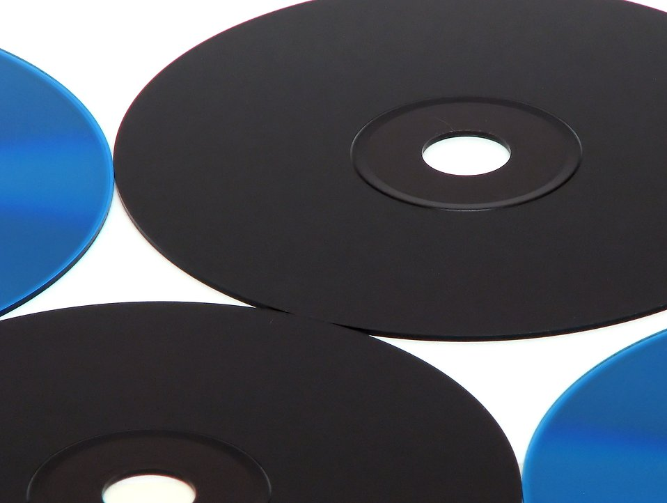 Blue and black cds isolated on a white background. : Free Stock Photo