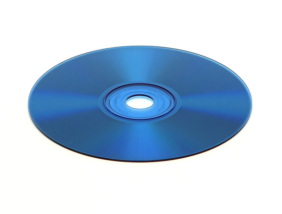 A blue cd isolated on a white background : Free Stock Photo