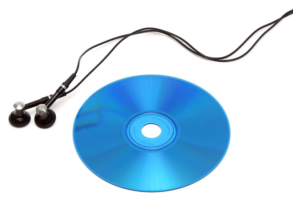A blue cd with headphones isolated on a white background. : Free Stock Photo