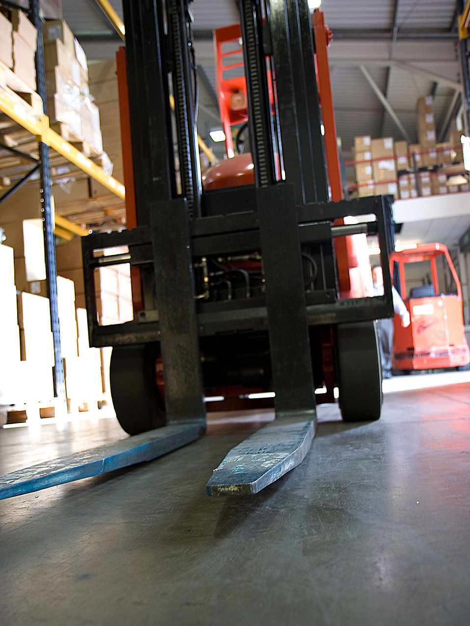 A forklift in a warehouse : Free Stock Photo