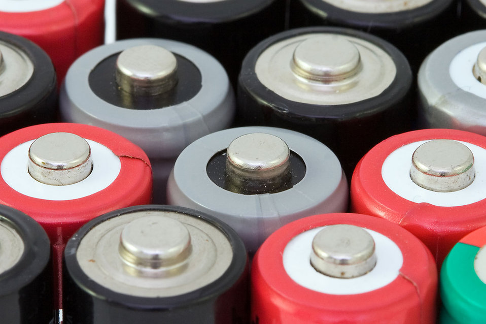 Close-up of AA battery tops : Free Stock Photo