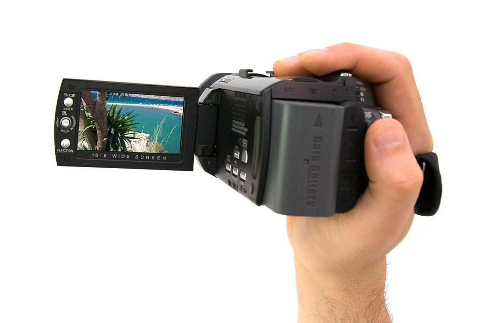 A hand holding a camcorder : Free Stock Photo