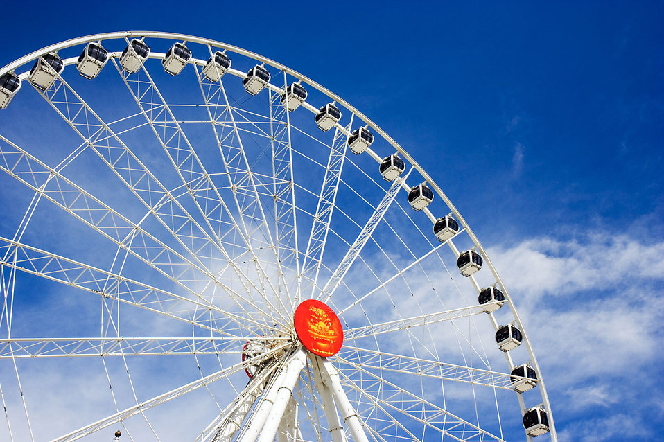 A large ferris wheel with a blue sky background : Free Stock Photo