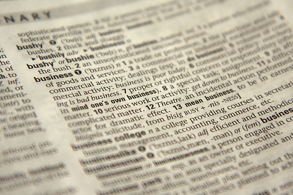 Close-up of the word business in the dictionary : Free Stock Photo
