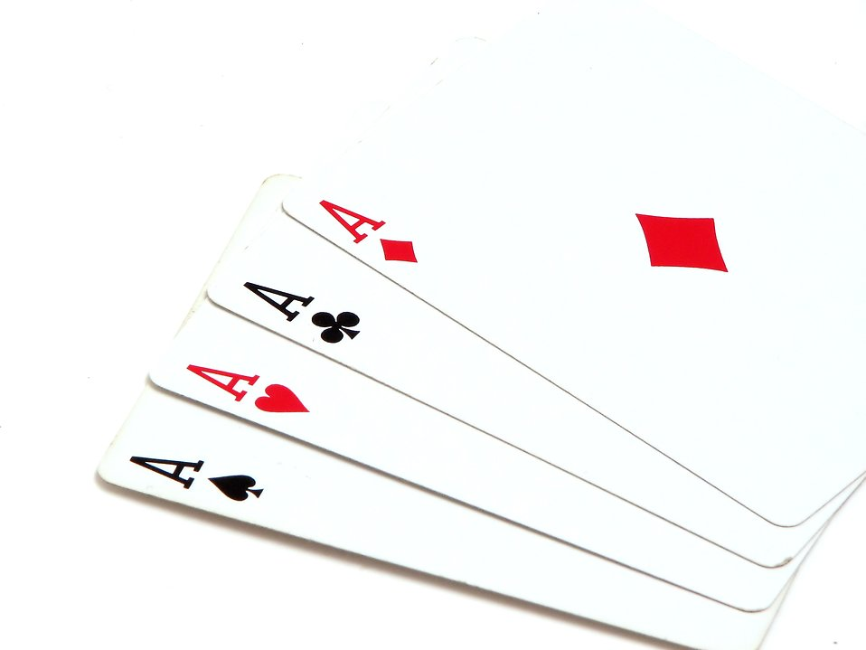 Four aces isolated on a white background : Free Stock Photo