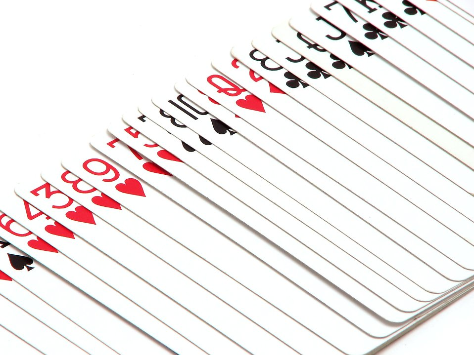 Playing cards fanned out on a white background : Free Stock Photo