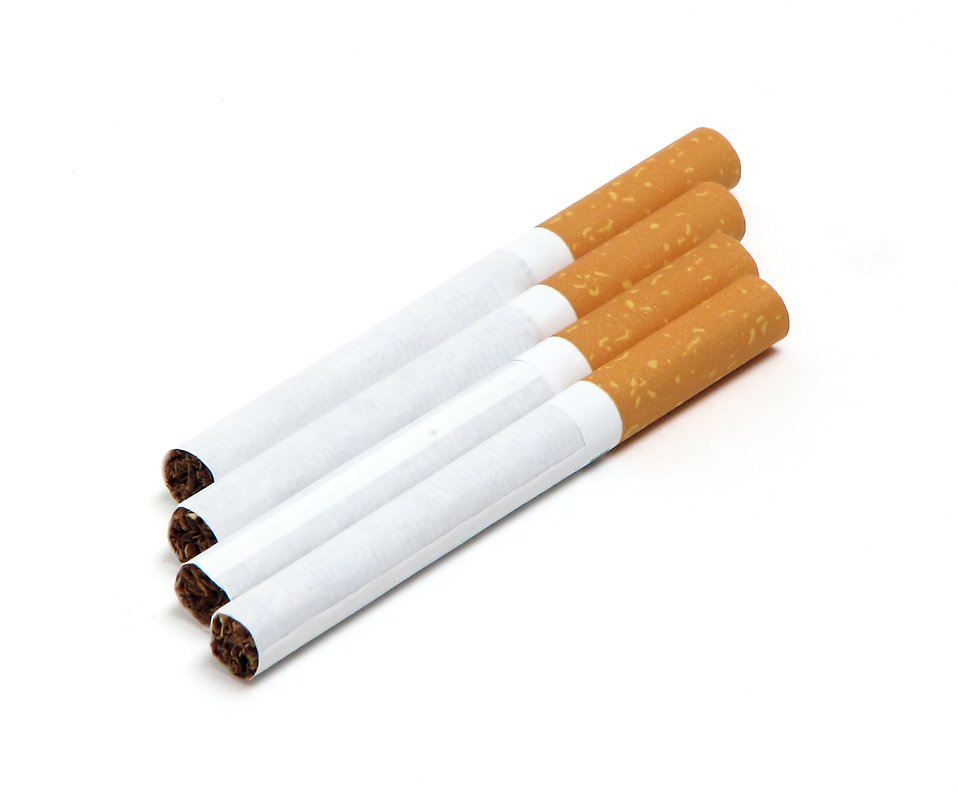Cigarettes isolated on a white background : Free Stock Photo