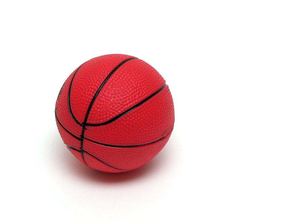 A toy basketball isolated on a white background : Free Stock Photo