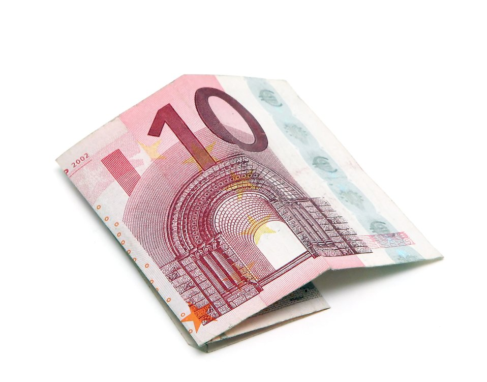 A ten Euro note folded on a white background : Free Stock Photo