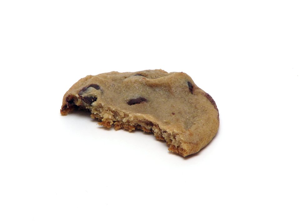 A half eaten chocolate chip cookie isolated on a white background : Free Stock Photo