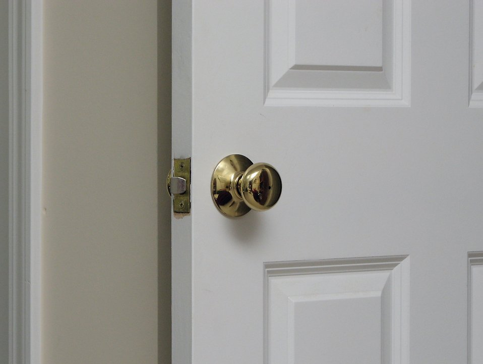 A white door and door handle : Free Stock Photo
