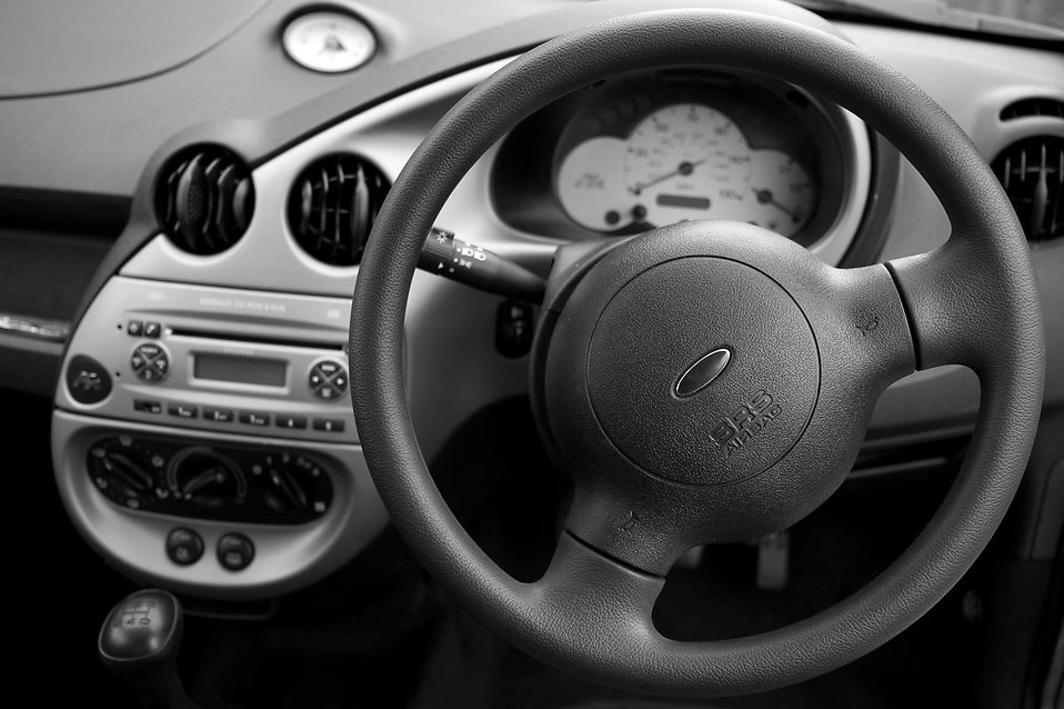 A car dashboard with steering wheel : Free Stock Photo