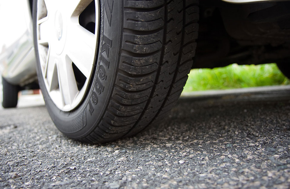 Close-up of a car tire : Free Stock Photo