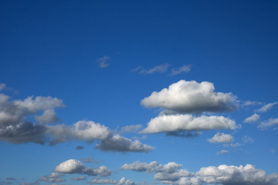 A blue sky with white clouds : Free Stock Photo
