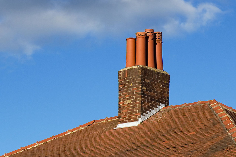 A chimney on the roof of a house : Free Stock Photo