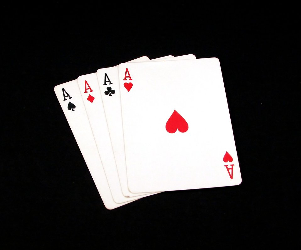 Four aces isolated on a black background : Free Stock Photo