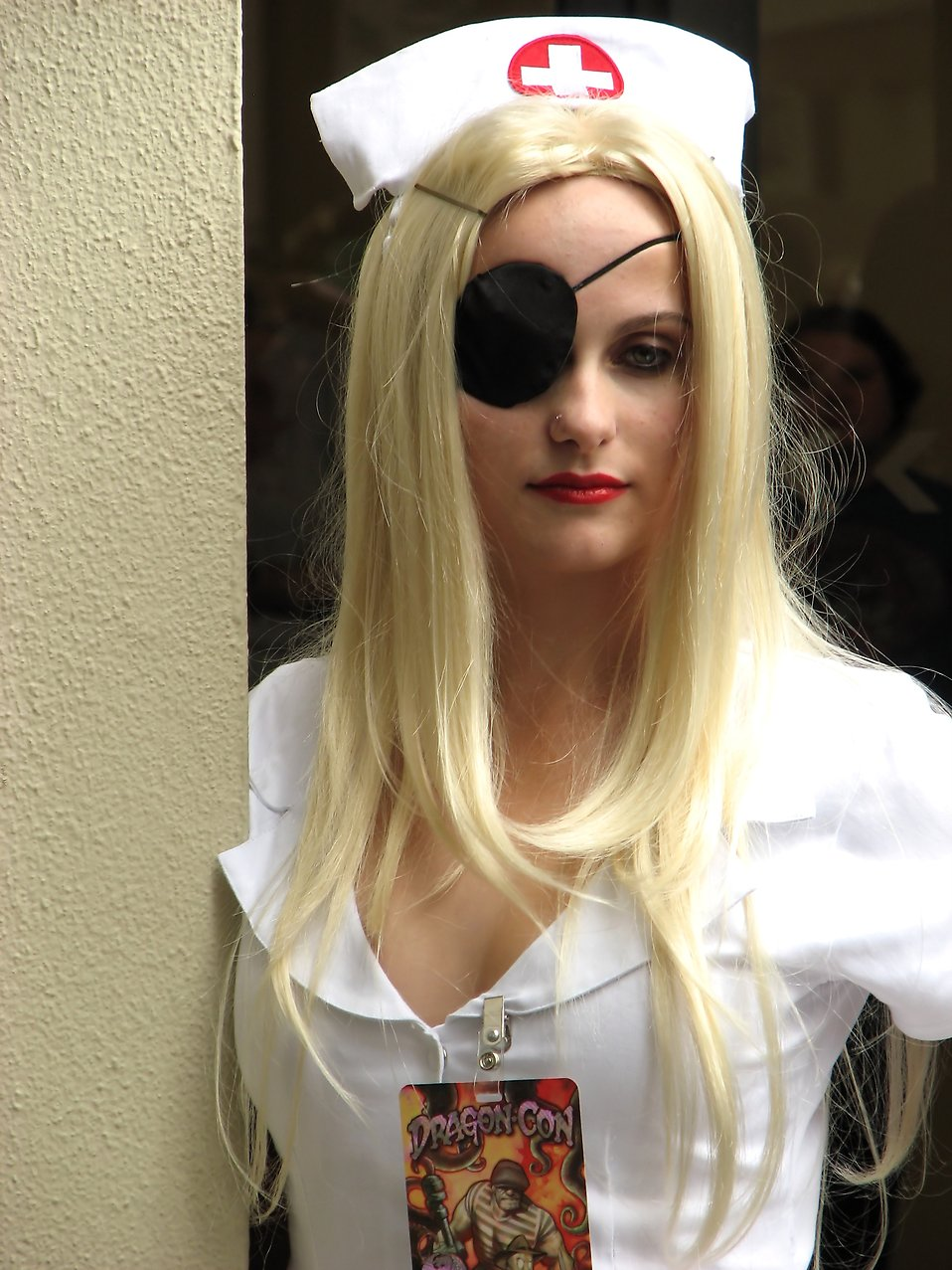 A beautiful girl in a nurse costume with an eye patch at Dragoncon 2009 in Atlanta, Georgia : Free Stock Photo