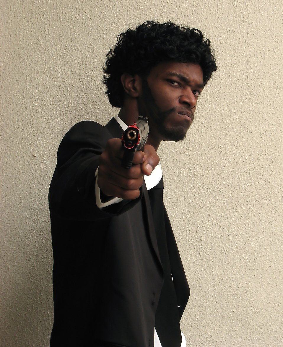 An African American man in a Pulp Fiction costume at Dragoncon 2009 in Atlanta, Georgia : Free Stock Photo