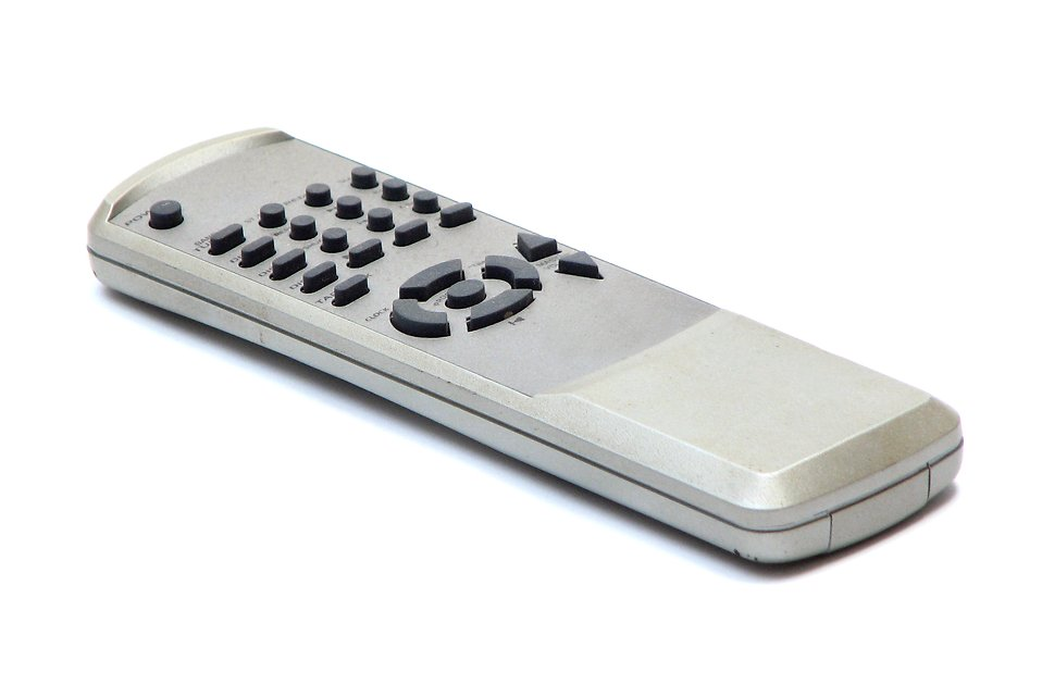 A DVD remote control isolated on a white background.