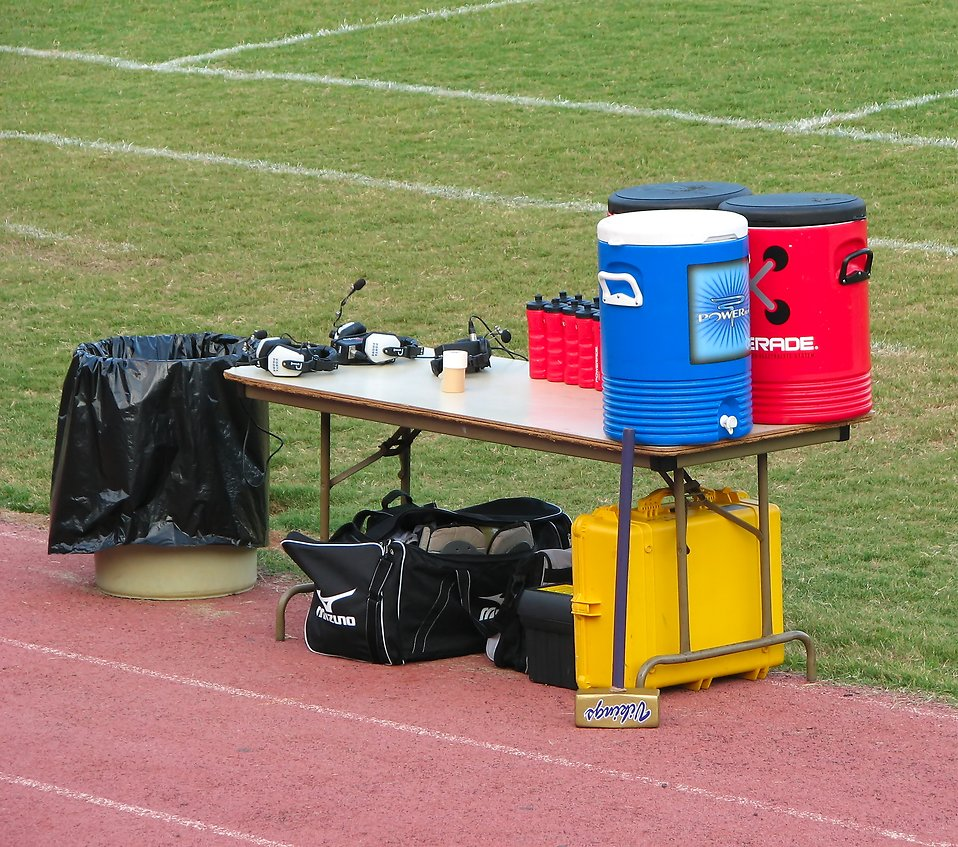 Water coolers and headsets on a sports field sideline : Free Stock Photo